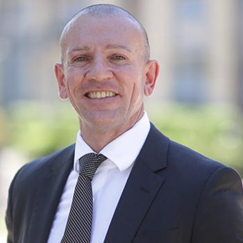 Prof Andrew Delios